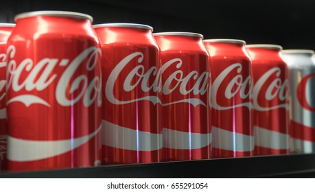 New York City, Circa 2017: Coca-Cola cans in row on store shelf for customer purchase. Consumer product soft drink company in beverage business. Illustrative Editorial