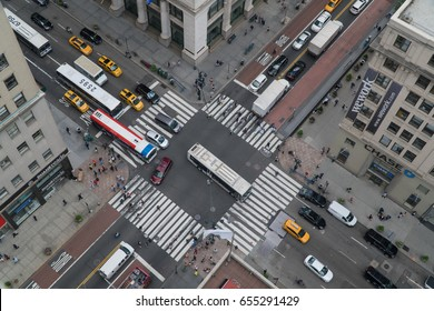 New York City, Circa 2017: Overhead aerial birds eye view overhead busy Manhattan intersection day time. People, bus, yellow taxi traffic travel downtown avenue.