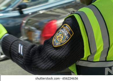 New York City, Circa 2017: NYPD Traffic police officer badge sleeve patch. Day time exterior Police Department direct rush hour commute traffic Manhattan