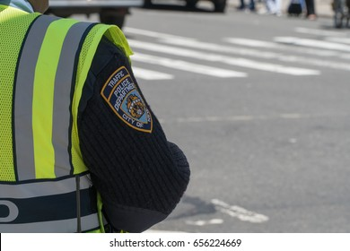 New York City, Circa 2017: NYPD Traffic police officer directing traffic during morning rush hour commute. Badge patch on sleeve of uniform