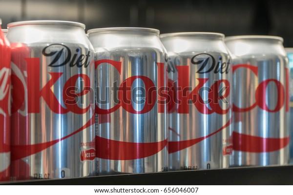 New York City, Circa 2017: Diet Coke cans on store shelf for customer purchase. Illustrative Editorial product photo. Coca Cola health alternative