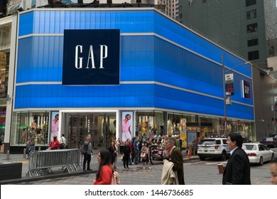 New York City, Circa 2019: GAP inc retail flagship store in Times Square manhattan. Day time exterior fashion clothing store neon sign facade