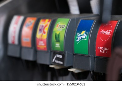 New York City, Circa 2019: Coca Cola drink brand soda fountain dispenser with variety of carbonated beverage taps mix water with syrup and fizz