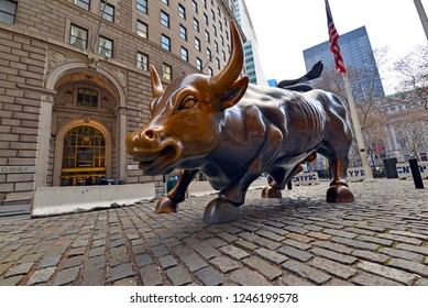 NEW YORK CITY CIRCA DECEMBER 2018. Known as a symbol of capitalism and prosperity, the Charging Bull is a Wall Street icon and popular tourist attraction located in downtown Manhattan.