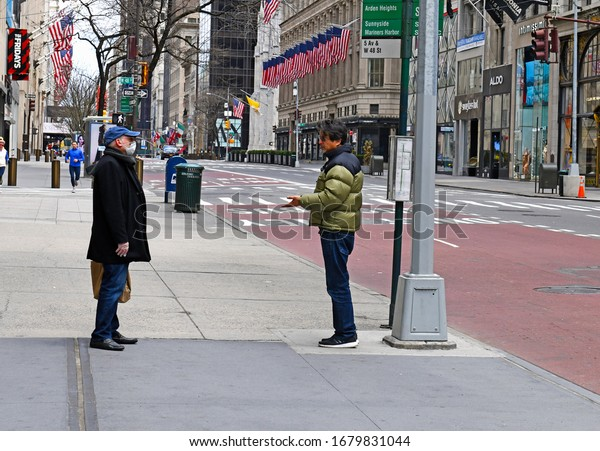 NEW YORK CITY CIRCA MARCH 2020. As the COVID-19 coronavirus pandemic broadens in scope, a new behavior to separate people called Social Distancing is being commonly seen on the street as shown here.