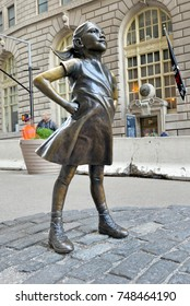 NEW YORK CITY CIRCA NOVEMBER 2017. Fearless Girl opposite the Charging Bull in lower Manhattan aims to focus on gender equality and claims to bring attention to lack of women leaders on Wall Street