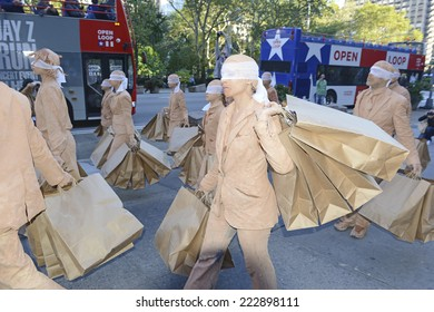 NEW YORK CITY - CIRCA OCTOBER 2014.  Performing Arts demonstration along tourist-rich 5th Avenue illustrating the concepts of blind consumerism, materialism and never having enough.