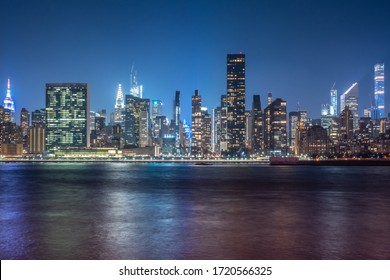 New York City Cityscape during Night Time with busy skyline and dense skyscrapers filling up the sky