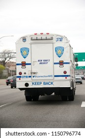 New York City Corrections bus on westbound side of Grand Central Parkway, Queens, New York, U.S.A., April 16, 2018