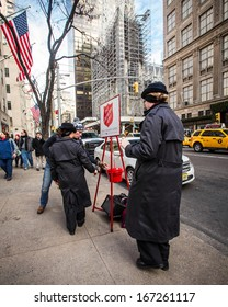 NEW YORK CITY - DEC 13:  Salvation Army workers perform for collections on Dec. 13, 2013 in midtown Manhattan.  This Christian organization  is known for its charity  work, operating in 126 countries