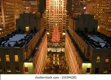 NEW YORK CITY - Dec, 2005: New York City landmark, Ice skaters and tourists on December, 2005, visit the famous Rockefeller Center Christmas tree during the holidays.