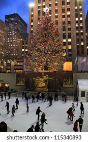 NEW YORK CITY - DEC. 5, 2011: New York City landmark, Ice skaters and tourists on December 5, 2011, visit the famous Rockefeller Center Christmas tree during the holidays.