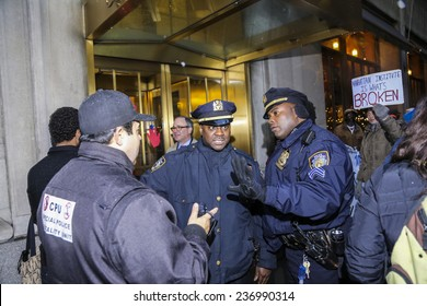 """NEW YORK CITY - DECEMBER 10 2014:Picture the Homeless, an advocacy group, staged a rally against the """"broken windows"""" philosophy & NYPD commissioner William Bratton in front of the Manhattan Institute"""