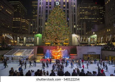 NEW YORK CITY - DECEMBER 10, 2015: Ice skaters fill the skating rink under the Rockefeller Center Christmas tree, a popular holiday tourist attraction in Midtown Manhattan.