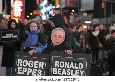 NEW YORK CITY - DECEMBER 12 2014: Carry the Names staged a rally in Times Square where 60 activists held signs naming people killed or injured by law enforcement