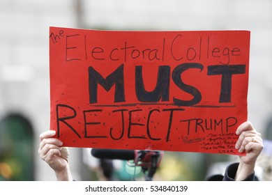 """NEW YORK CITY - DECEMBER 12 2016: Hundreds of activists gathered in front of Trump International in Columbus Circle for a """"Not My President!"""" rally & march against the inauguration of Donald Trump."""