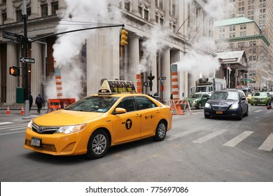 NEW YORK CITY - DECEMBER 12, 2017: New York City Taxi in Manhattan. New York City has around 6,000 hybrid taxis, representing almost 45 of the taxis in service, the most in any city in North America