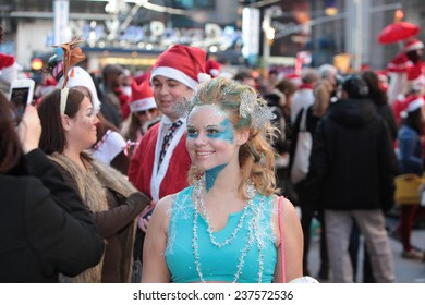 NEW YORK CITY - DECEMBER 13 2014: hundreds of costumed revelers filled Times Square to muster for the 17th annual SantaCon pub crawl, scaled back this year due to concerns over rowdy behavior