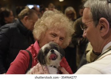 NEW YORK CITY - DECEMBER 13 2015: Cindy Adams joined commissioner Bratton to host the annual Blessing of the Animals at Christ Church in Manhattan. Rabbi Peter Rubinstein confers blessing