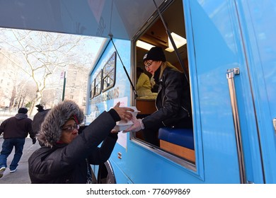 NEW YORK CITY - DECEMBER 13 2017: The North Brooklyn Angels Food Truck makes its regular stop to deliver free lunches in Brooklyn's Williamsburg