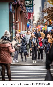 NEW YORK CITY - DECEMBER 14, 2018:  Winter street scene in New York City Manhattan with real people in everyday situation on busy urban street