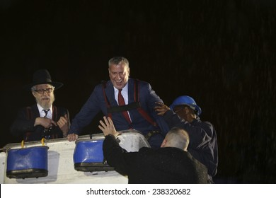 "NEW YORK CITY - DECEMBER 16 2014: Mayor Bill De Blasio & Rabbi Shimon Hecht of Cabad presided over lighting of the ""world's largest menorah"" in Grand Army Plaza to mark the first night of Chanukah"