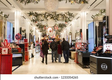 NEW YORK CITY - DECEMBER 17, 2017:  View from the inside of the famous Macy's Department Store at Herald Square in Manhattan during Christmas Holiday season with people shopping.