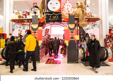 NEW YORK CITY - DECEMBER 17, 2017:  View of inside of famous Macy's Department Store at Herald Square in Manhattan during Christmas Holiday season with people shopping at FAO Schwarz display