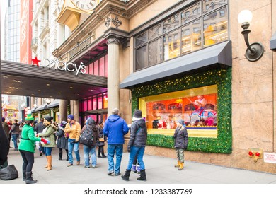 NEW YORK CITY - DECEMBER 17, 2017:  Street scene from Macy's Department Store at Herald Square in Manhattan with holiday window displays and people.