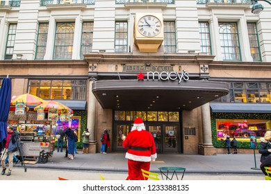 NEW YORK CITY - DECEMBER 17, 2017:  Street scene from Macy's Department Store at Herald Square in Manhattan with holiday window displays, people and Santa.