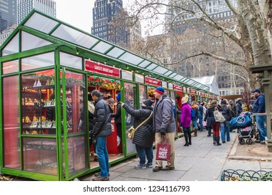 NEW YORK CITY - DECEMBER 17, 2017:  View of holiday shoppers at outdoor Christmas Boutiques at Bryant Park in Manhattan on a December day.