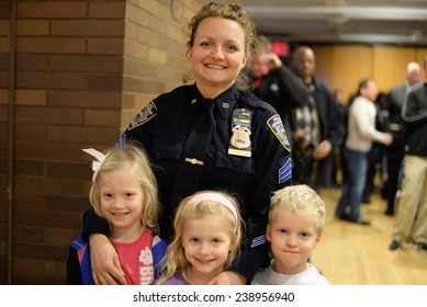 NEW YORK CITY - DECEMBER 19 2014: several dozen NYPD officers were promoted in a ceremony held at One Police Plaza, presided over by Mayor Bill De Blasio & NYPD Commissioner William Bratton