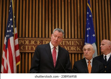 "NEW YORK CITY - DECEMBER 19 2014: following a promotion ceremony at 1 Police Plaza, Mayor De Blasio & NYPD Commissioner William Bratton reaffirmed their commitment to ""broken windows"" policing in NYC"