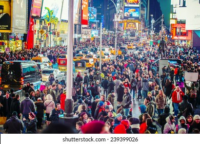 NEW YORK CITY - DECEMBER 20: Times Square crowds at night on December 20, 2014 in Midtown of Manhattan, New York City, USA. It is the last Saturday before Christmas.