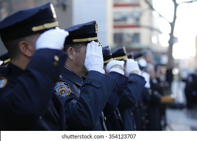 NEW YORK CITY - DECEMBER 20 2015: mayor de Blasio joined the families of Wenjian Liu and Rafael Ramos to dedicate a plaque in their memory at the 84th precinct. Officers in dress uniforms salute