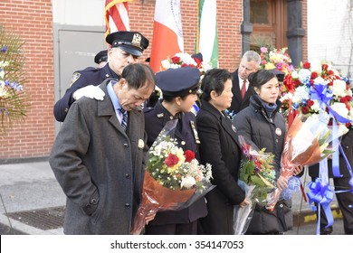 NEW YORK CITY - DECEMBER 20 2015: mayor de Blasio joined the families of slain officers Wenjian Liu and Rafael Ramos to dedicate a plaque at the 84th precinct. Liu family at Tompkins & Myrtle Avenues