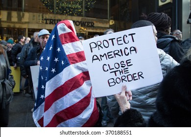 NEW YORK CITY - DECEMBER 20 2015: A rally between Pro & Anti Trump protestors outside of the Trump Towers on 5th Avenue New York, NY.