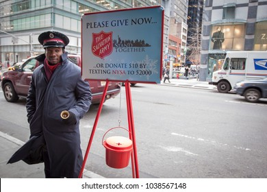 New York City - December 22 2010: Salvation Army soldier rings the bell for donationin midtown Manhattan during Christmas season.