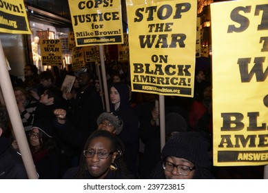 NEW YORK CITY - DECEMBER 23 2014: several hundred protesters filled Fifth Avenue to march against police brutality & holiday consumerism in defiance of Mayor De Blasio's call for a halt to protests