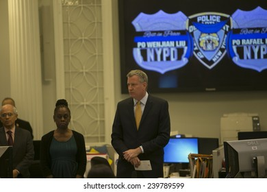 """NEW YORK CITY - DECEMBER 23 2014: Mayor Bill De Blasio led City Hall staffers in a moment of silence in memory of slain NYPD officers Wenjin Liu & Rafael Ramos in the city hall """"bull pen"""" office"""