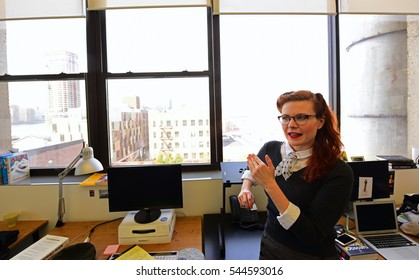 NEW YORK CITY - DECEMBER 23 2016: Ella Morton, of Atlas Obscura, a journal of hard-find-travel curiosities, was interviewed by Peter Stableman of the Daily Eagle in Atlas Greenpoint offices