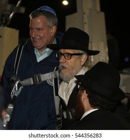 NEW YORK CITY - DECEMBER 24 2016: Chabad of Park Slope sponsored its annual giant menorah lighting in Grand Army Plaza to mark the first night of Hanukkah. Rabbi Shimon Hecht with Mayor de Blasio