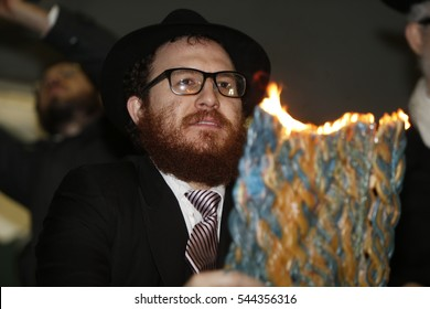 NEW YORK CITY - DECEMBER 24 2016: Chabad of Park Slope sponsored its annual giant menorah lighting in Grand Army Plaza to mark the first night of Hanukkah. Rabbi Mendy Hecht of Prospect Heights