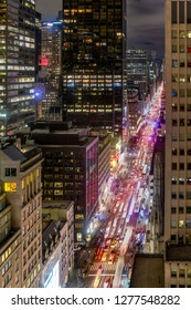New York City - December 25, 2018: New York City skyline in midtown Manhattan as cars drive through the city in the evening.