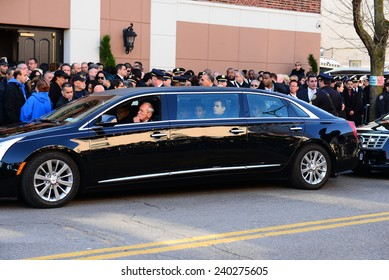NEW YORK CITY - DECEMBER 27 2014: along with political leaders, uniformed police officers from all over north America attended funeral services for officer Rafael Ramos. Elder son Justin Ramos in car