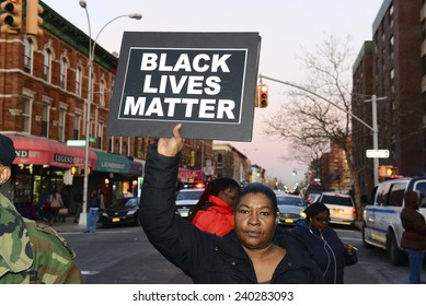 NEW YORK CITY - DECEMBER 27 2014: several protesters gathered at the Pink Houses for a march to Police Services Area #2 station demanding justice for Akai Gurley, who was killed by Peter Liang
