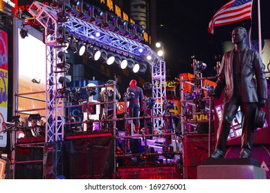NEW YORK CITY - DECEMBER 31 2013: The Times Square Alliance hosted the square's 110th New Year's Eve countdown with celebrities, crowds & cold temps,  George M. Cohan statue & Spiderman interviewed