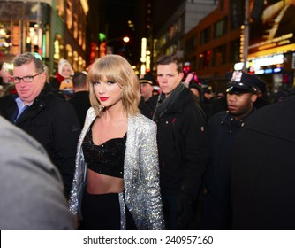 NEW YORK CITY - DECEMBER 31 2014: more than one million celebrants marked the new year in Times Square. Singer Taylor Swift arrives to perform just before midnight.