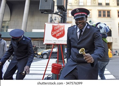 NEW YORK CITY - DECEMBER 5 2015: Salvation Army volunteers mark the holiday season in Midtown Manhattan by collecting for charity with some enthusiastic dance moves.