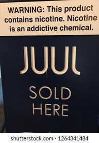 NEW YORK CITY - December  6, 2018: Advertisment for Juul e-cigarette in Manhattan. Ecigs have become so popular that it is now about 68% of the $2 billion e-cigarette market